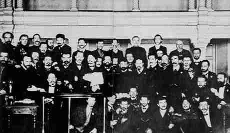 Trotsky (holding the brief case) among the members of the Petrograd Soviet, during their trial